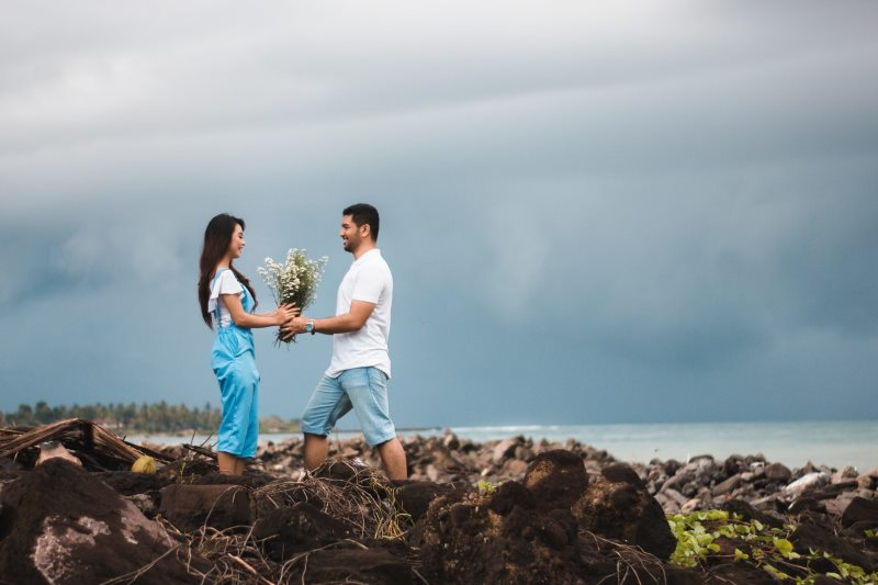 Man Interest Chasing Giving Flowers To Woman