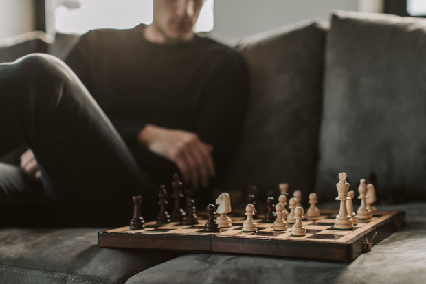 Man Playing Hard Chess Game