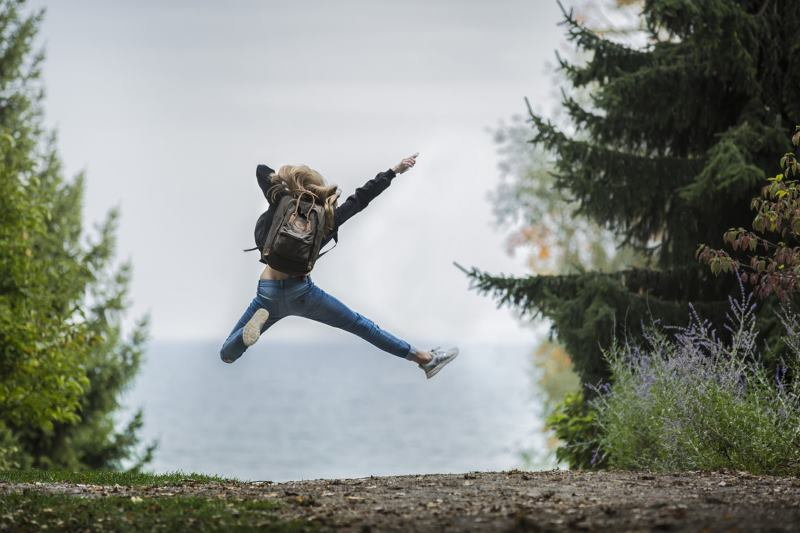 Woman Jumping Out Her Own Way