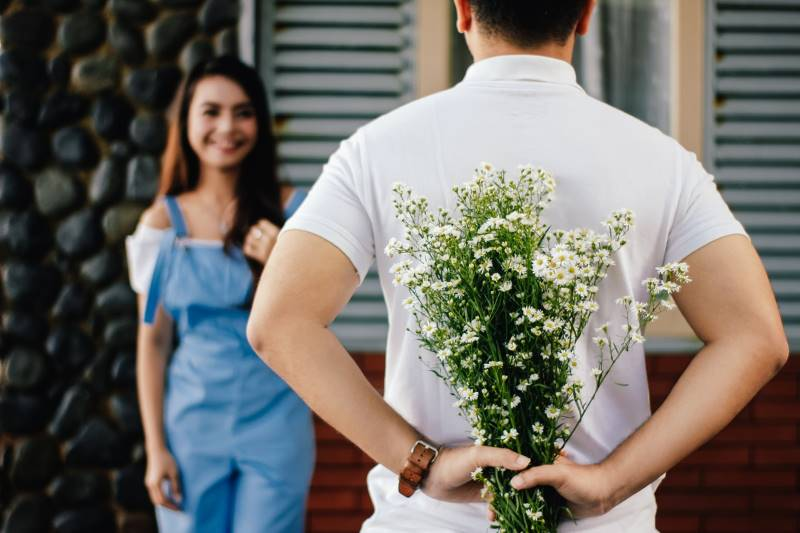 Man Missing Woman Giving Her Flowers Care